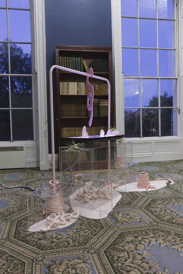 Barbara Knezevic    Scapes, (Rose Quartz ),   2018  Rosequartz crystals, pink opals, HD video composed of shutterstock footage, acrylic perspex, silicone, glazed earthenware, bisque fired earthenware, powder coated steel, airplants