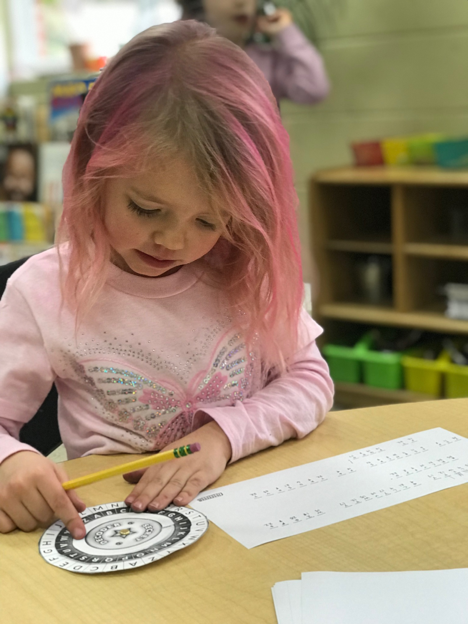 A simple cypher wheel that operates by rotating concentric circles is perfect for a kindergartener.