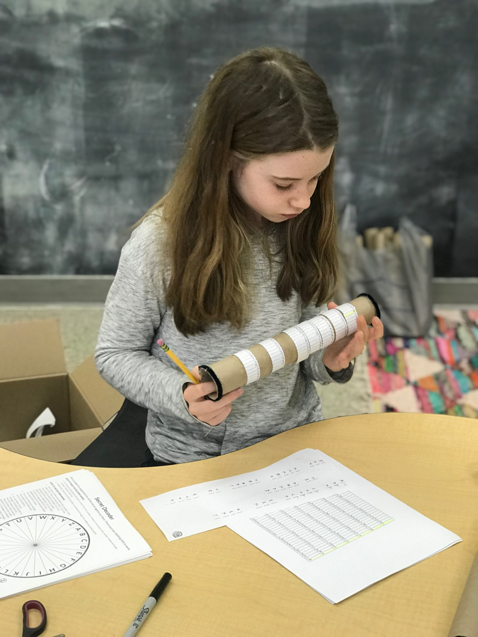 A more complicated cypher wheel, requiring numerous independently rotating paper wheels, provides a greater challenge for a 5th grader.