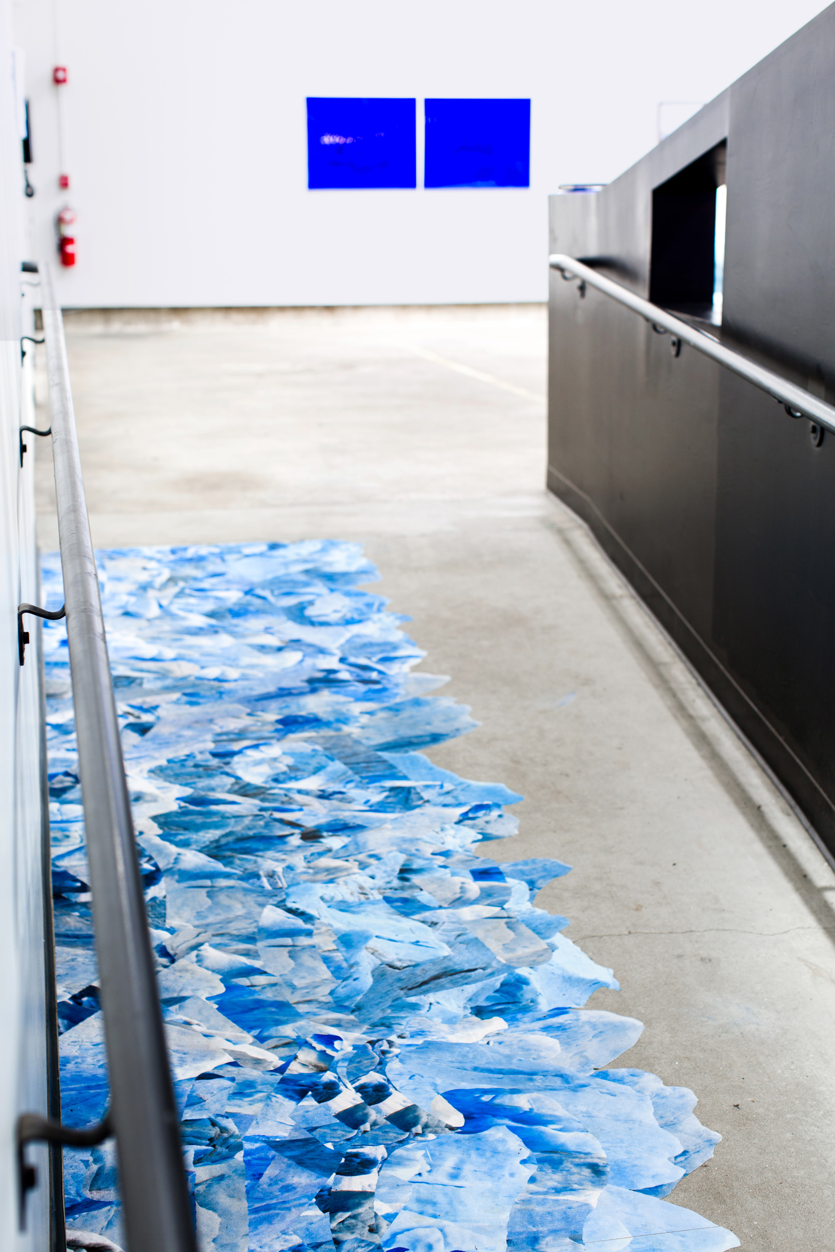 Justin Levesque, Walking Safely in Slippery Conditions, pigment print on ToughCoat vinyl flooring, 42x216, 2018
