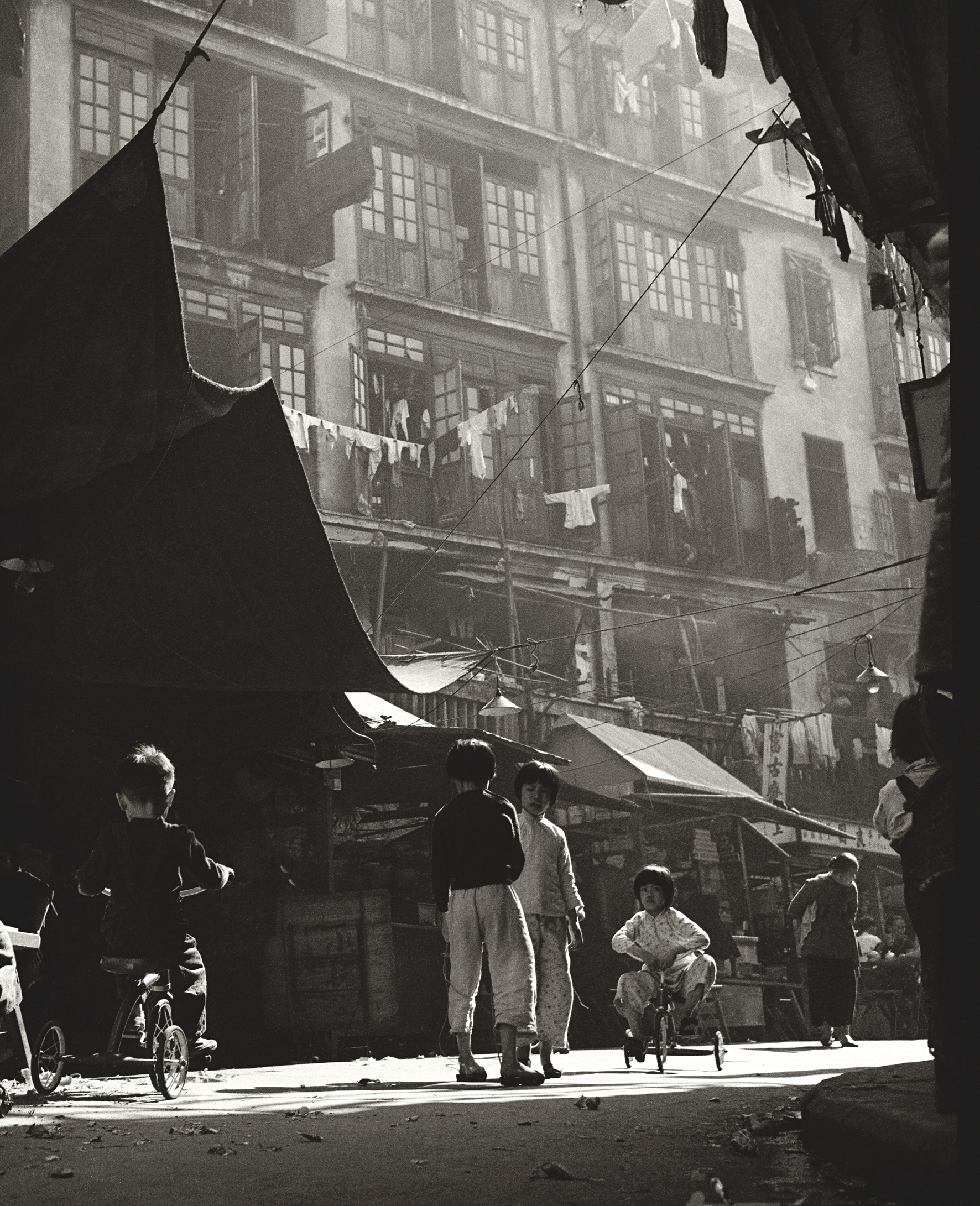 Fan Ho 'Age of Innocence in Sheung Wan (童趣)' Hong Kong 1950s and 60s, courtesy of Blue Lotus Gallery