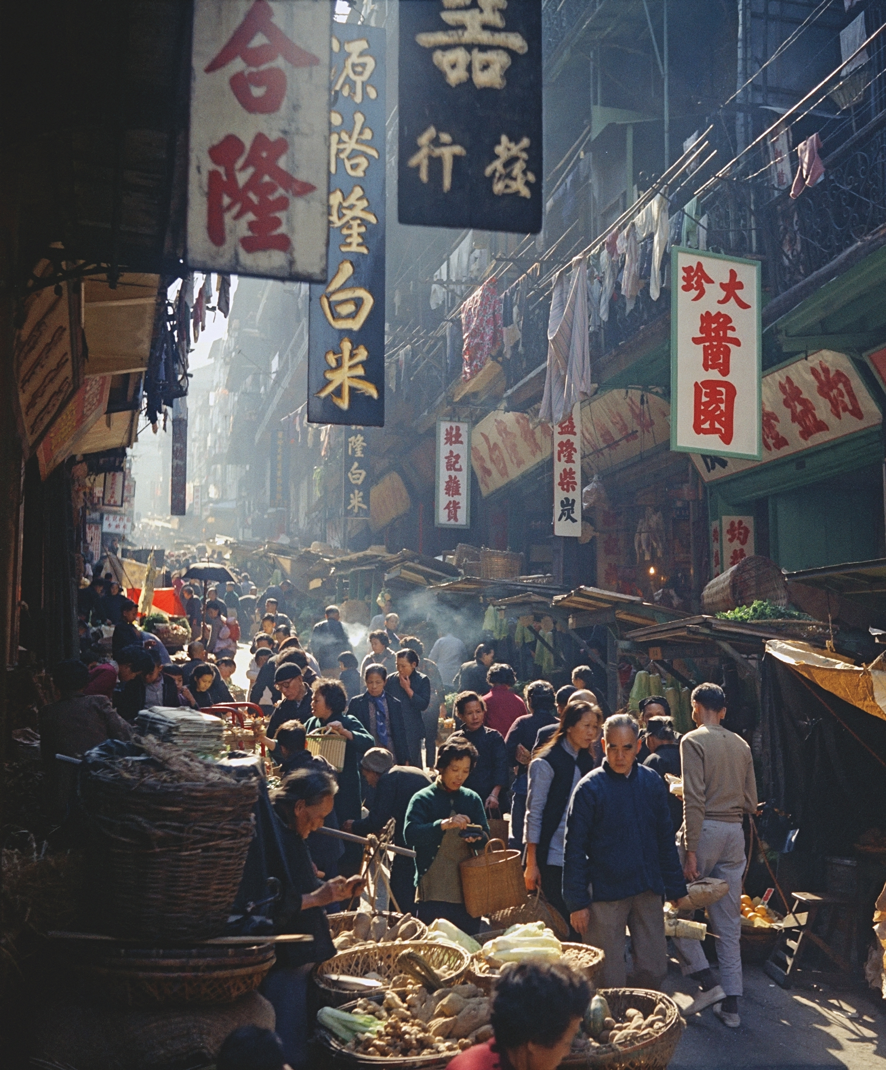 Fan Ho 'Market Promenade(開門七件事)' Hong Kong 1950s and 60s, courtesy of Blue Lotus Gallery