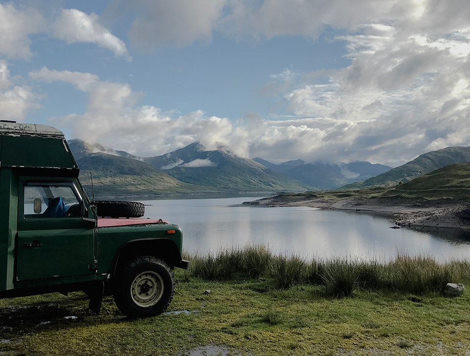 A Scottish loch and a Land Rover ambulance campervan