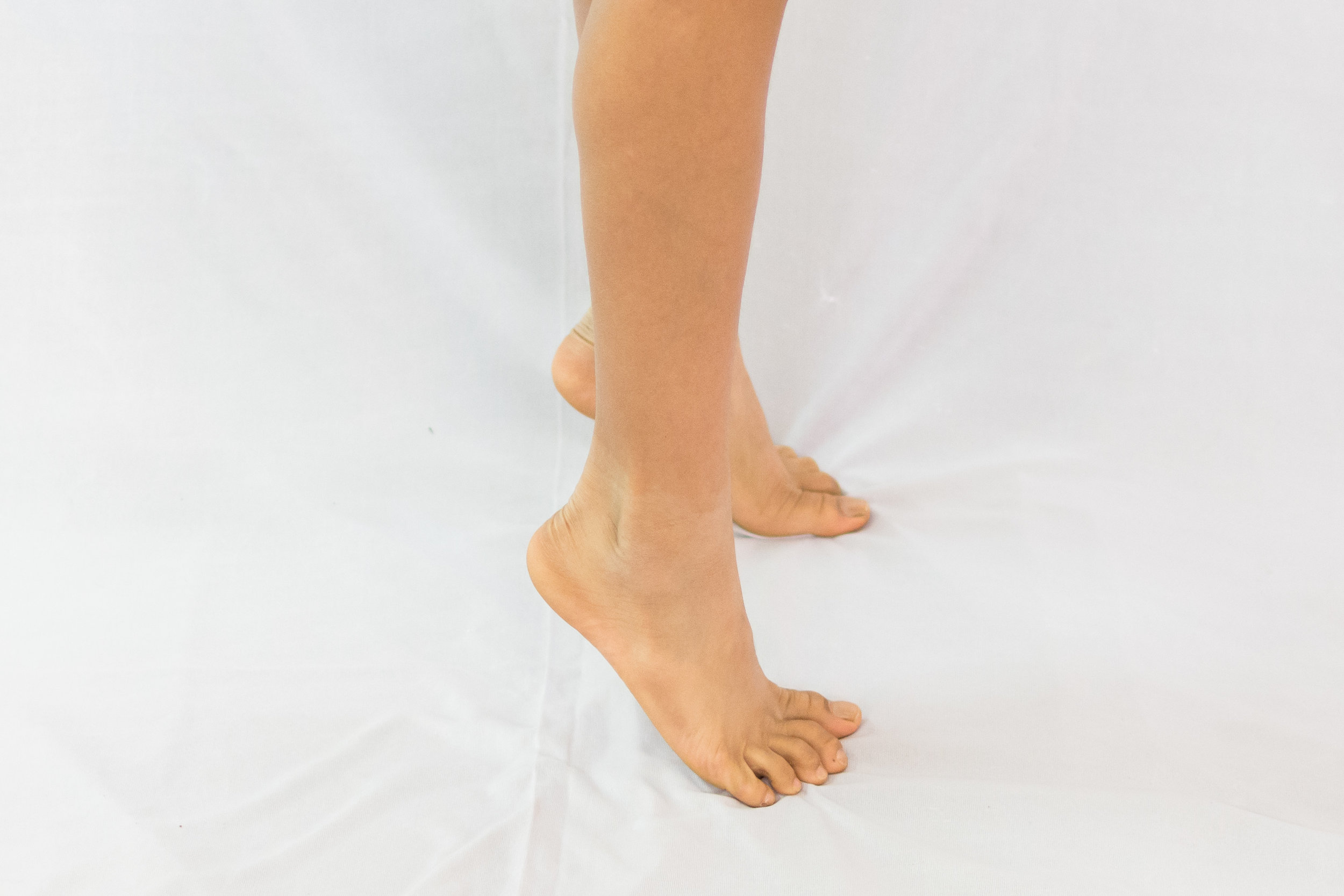 Elven Raises - Stand tall like a puppet as if the string is pulling you up. Now raise heels of both the feet off the ground as if you are being pulled up even further off the ground.Go up and down slowly without any jerky movements.It can be done anywhere, anytime.