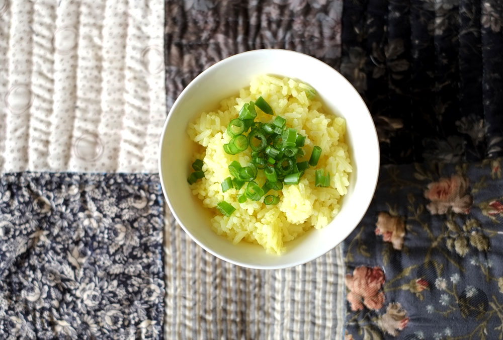 Garlic Butter Rice   Prep time: 5 mins  Cook time: 30 mins  Total time: 35 mins  Serves: 4-5      Ingredients:   · 2 cups of uncooked rice  · 5-6 cloves of minced Garlic  · 2 tablespoons unsalted Butter  · 1 teaspoon Salt  · 1/2 teaspoon Turmeric      Instructions:   1) Wash your rice in a rice cooker pot and throw in the minced garlic, unsalted  butter, turmeric and salt.  2) Mix evenly and cook with the amount of water as  indicated in your rice cooker or 1-3/4 cups of water to 1 cup of rice.  3) When the rice is cooked, use a large spoon and toss the freshly cooked rice  around (take in the fluffiness!), and season further if necessary (another half  teaspoon of salt, tops!).
