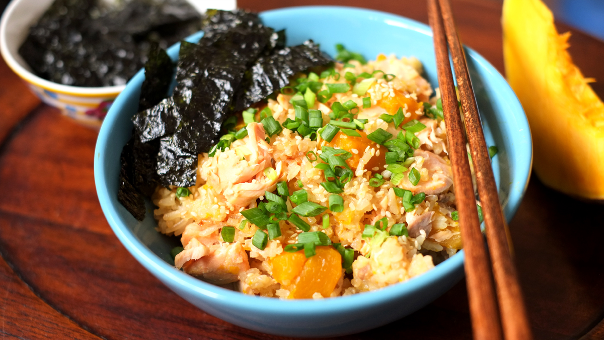 Japanese Steamed Salmon and Pumpkin Rice   Prep time: 5 mins  Cook time: 20 mins  Total time: 25 mins  Serves: 4-6     Ingredients:   · 2 cups White Rice  · 200g Pumpkin  · 250g Salmon Fillet  · 1/2 cup Soy Sauce  · 1/4 cup Mirin   For garnish:   · some chopped Spring Onions  · some strips of Nori/Japanese Seaweed    Instructions:  1) Wash and prepare the rice by adding the sufficient amount of water  required to cook it according to what is indicated in your rice cooker OR just  remember that the rice to water ratio is 1:2, in which case you will need 4  cups of water for 2 cups of rice.  2) After you have added the water to the rice, use a measuring cup and  remove 1/3 cup of water from the rice - this is because you will be adding  the seasoning to the rice to cook in the cooker and if you do not remove  some water, the rice will end up being too soggy.  3) Cut the pumpkin into cubes and add them in with the rice.  4) Next, remove the bones from the salmon fillet (if there are any) and cut into  4 pieces. Lay the salmon fillet pieces on top of the rice and pumpkin.  5) Finally, pour the soy sauce and mirin in with the rest of the ingredients.  Place in the rice cooker and cook.  6) Garnish with the spring onions and seaweed and serve hot! Enjoy~
