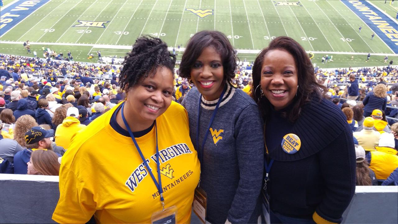 Enjoying a fall Mountaineer football game with friends