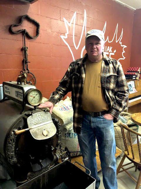 Chugiak Cafe  owner, Trig Bjorklund, with his 1910 coffee roaster