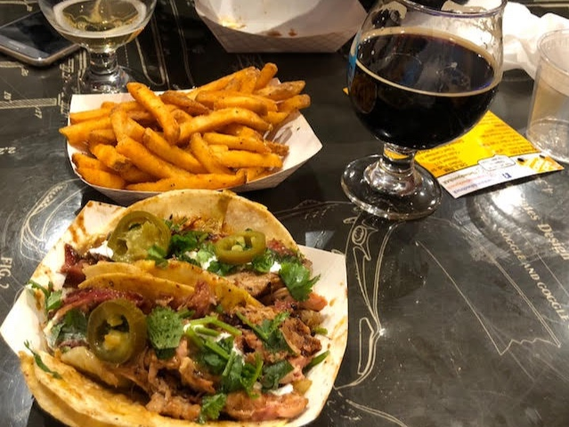 This amazingly delicious meal of pulled pork tacos and small-batch brewed beer is from  The Back Porch Food Truck  and  Girdwood Brewing Company ..