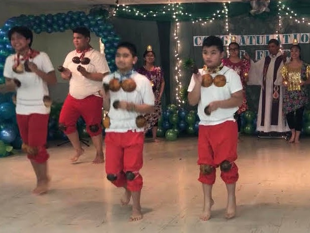 Filipino students dancing the traditional dance called maglalatik