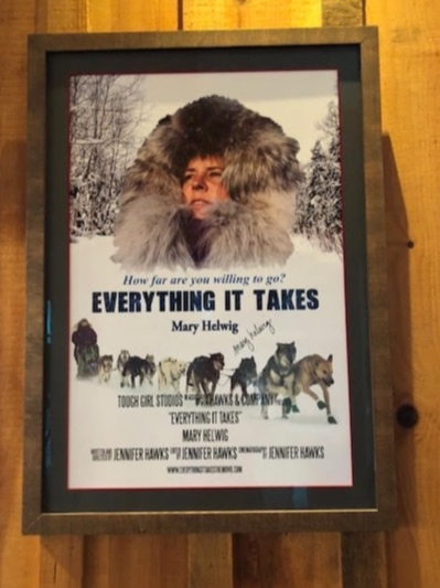 A movie poster advertising a documentary about daughter, Mary Helwig's, rookie year as an Iditarod racer.
