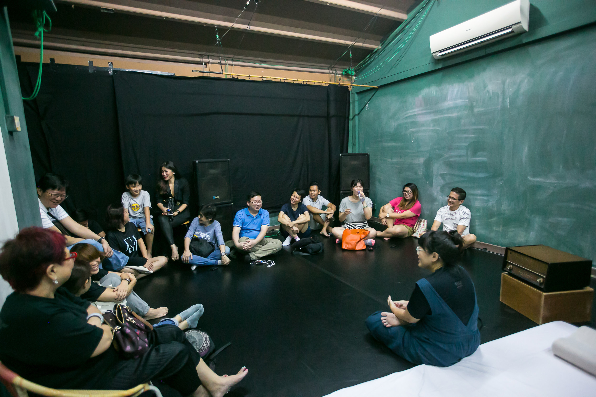Drama Box's Associate Artistic Director, Koh Hui Ling, having a friendly conversation with the participants of the Sounds of Chinatown workshop