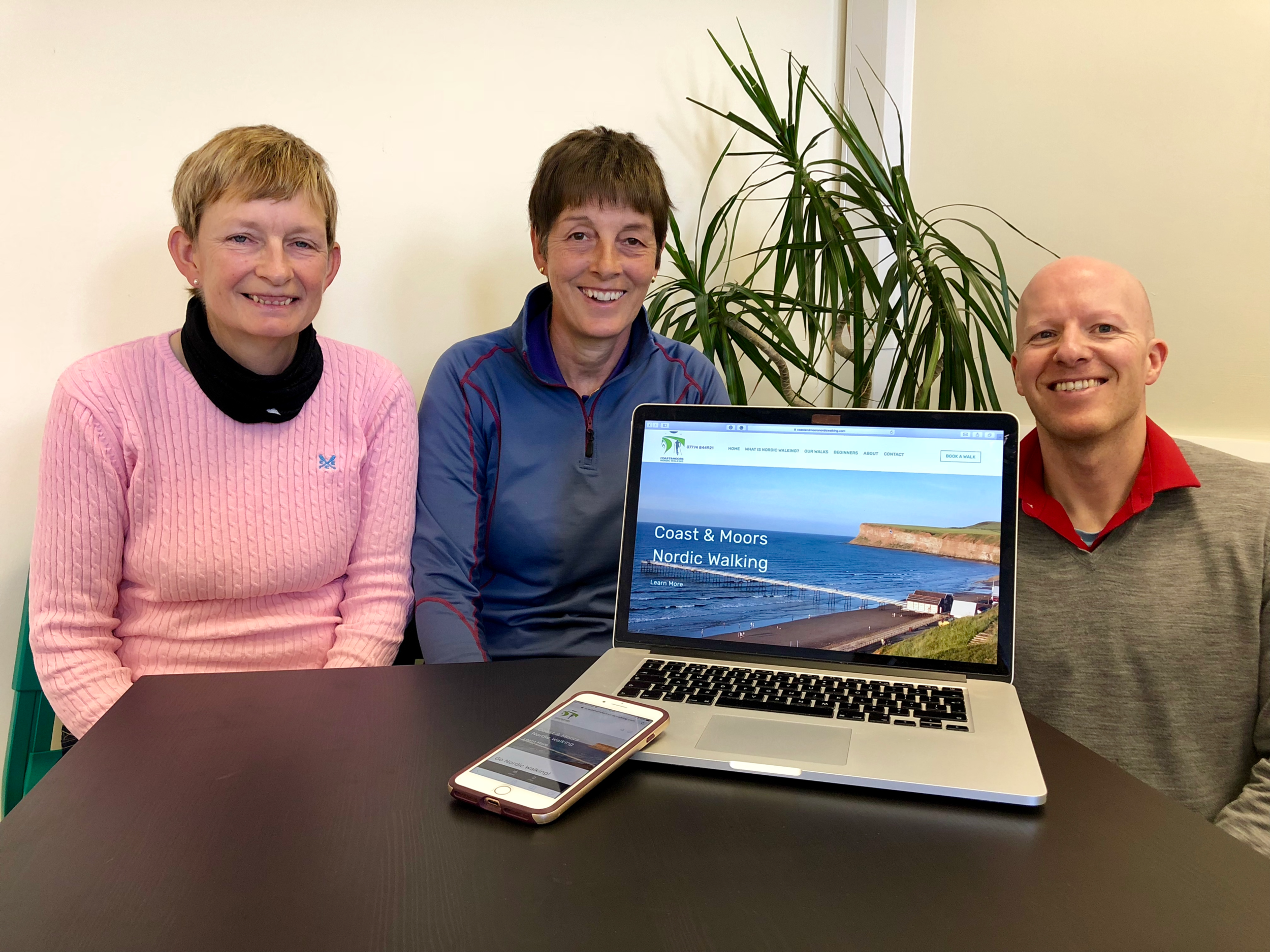 Pat Smillie (left) and Jo Davy (centre) from Coast and Moors Nordic Walking with Darren Winter from Duco Digital