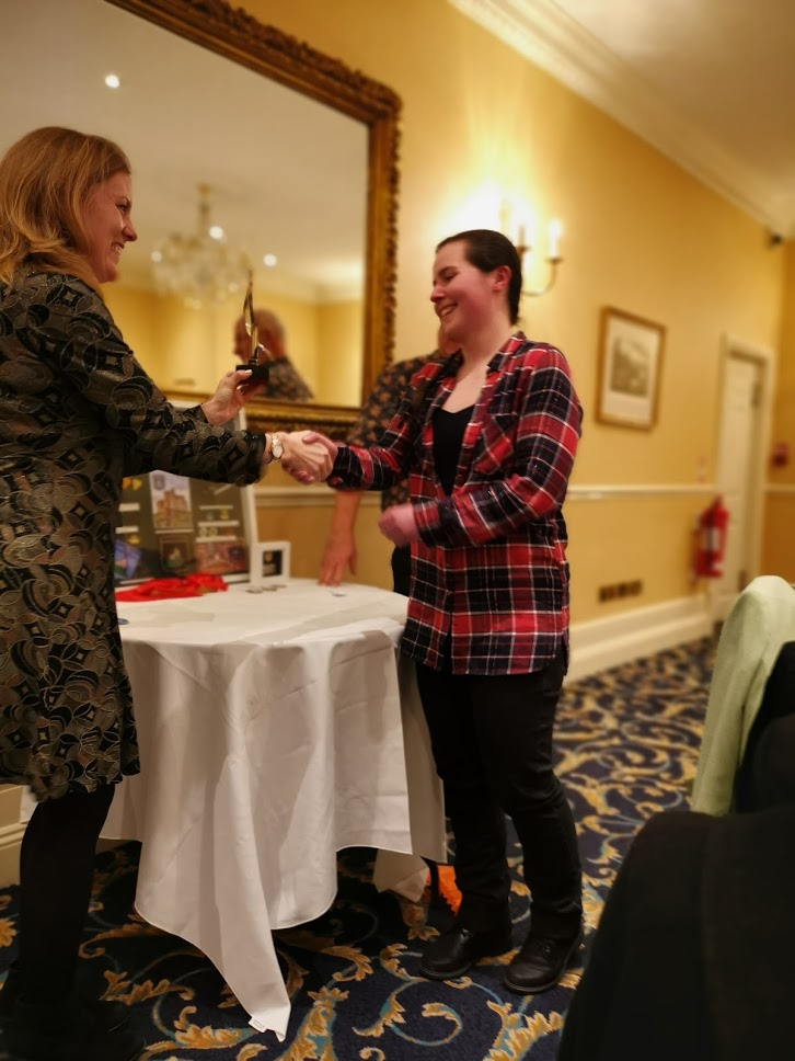 Junior Master Bowman Sarah being presented with her trophy