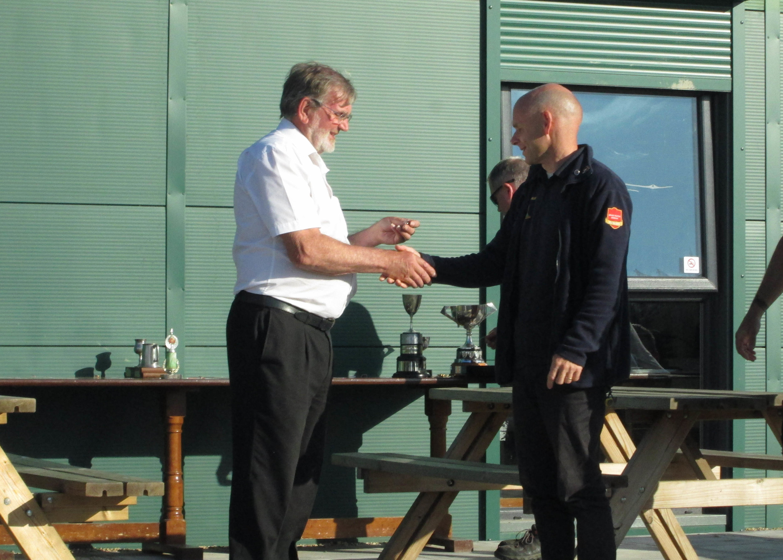 Mike Wo collecting his Silver