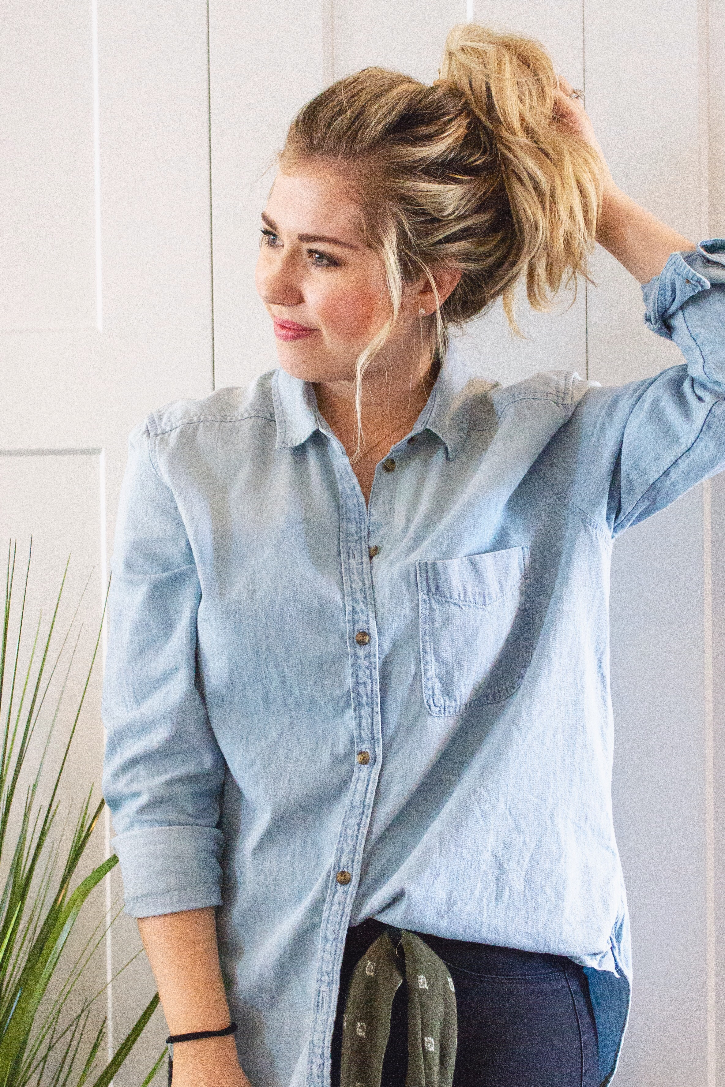 STEP 1: Secure in High Ponytail - Secure the hair into a high ponytail with your first hair tie, making sure to place it where you want your topknot to end up.