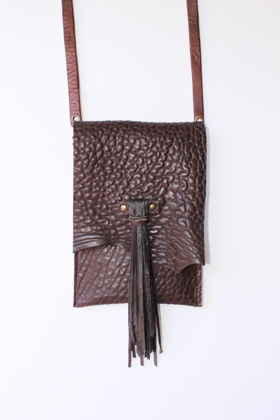 Textured brown cowhide bag with long soft lambskin tassel.  $128..jpg