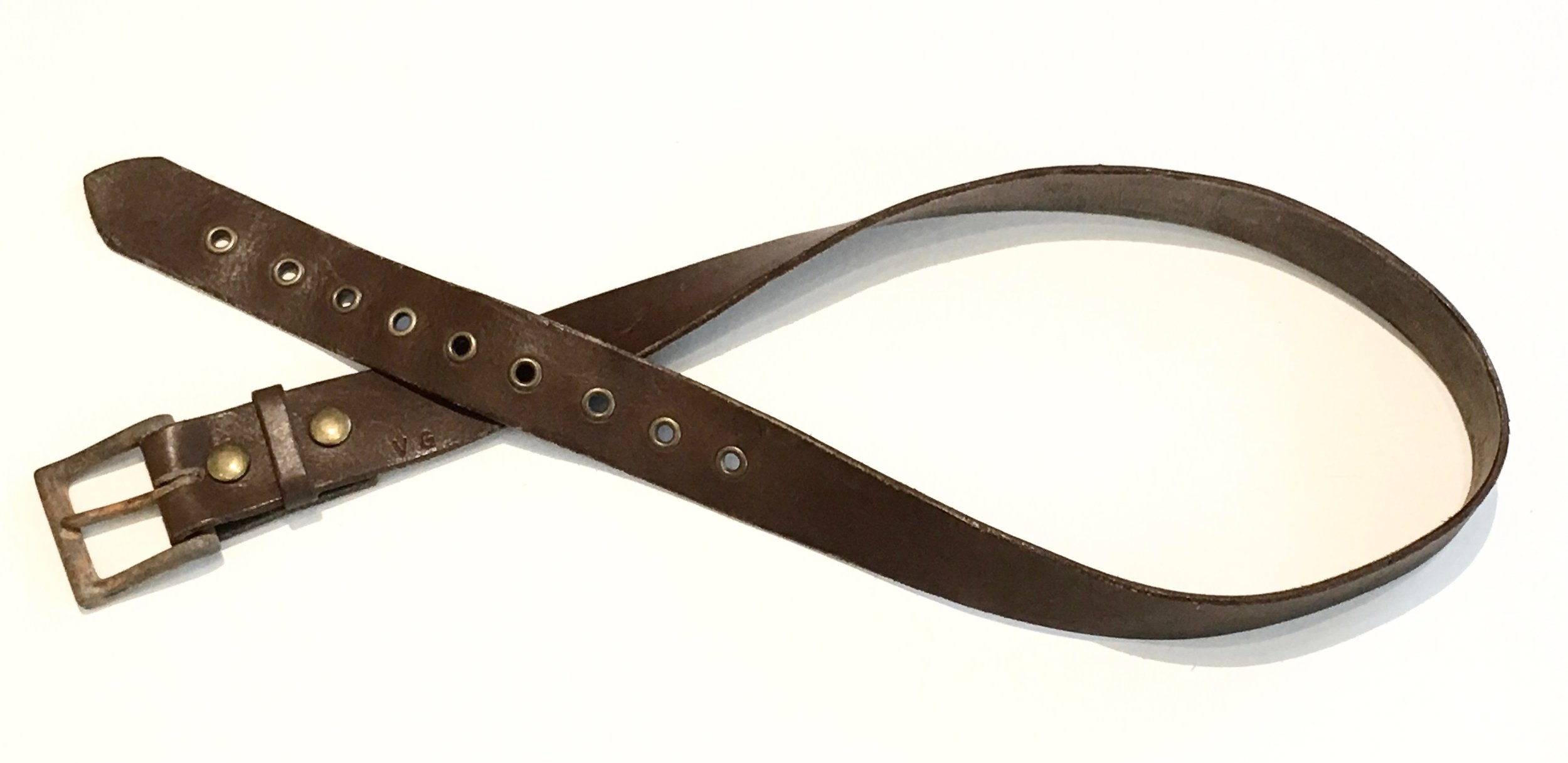 Brown Leather belt, lightly distressed with antique brass metal and rust style buckle. $125..jpg