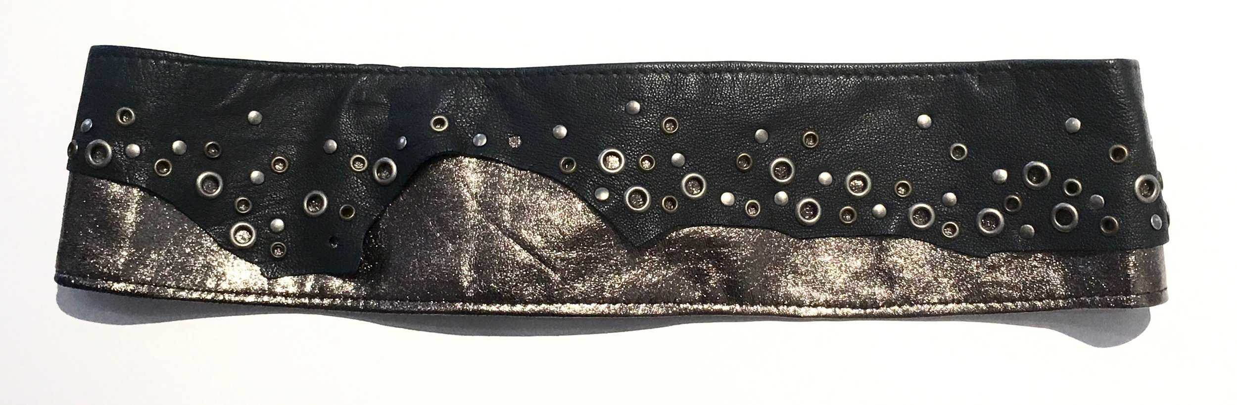 Black and bronze metallic lambskin with antiques brass and nickel metal work.  Brass ring with adjustable velcro closure. Back view..jpg