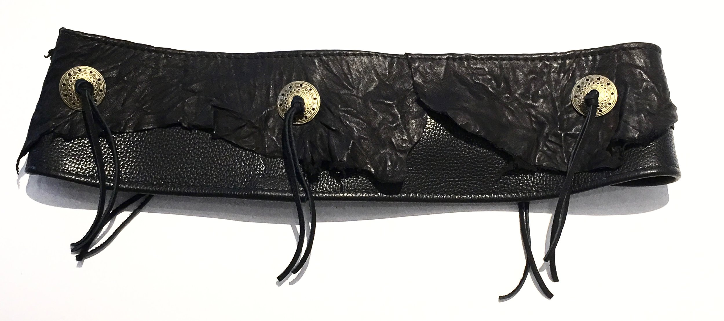Black cowhide HipWear with Lamskin overlay and brass conchos. Brass ring with adjustable velcro closure. Back view..jpg