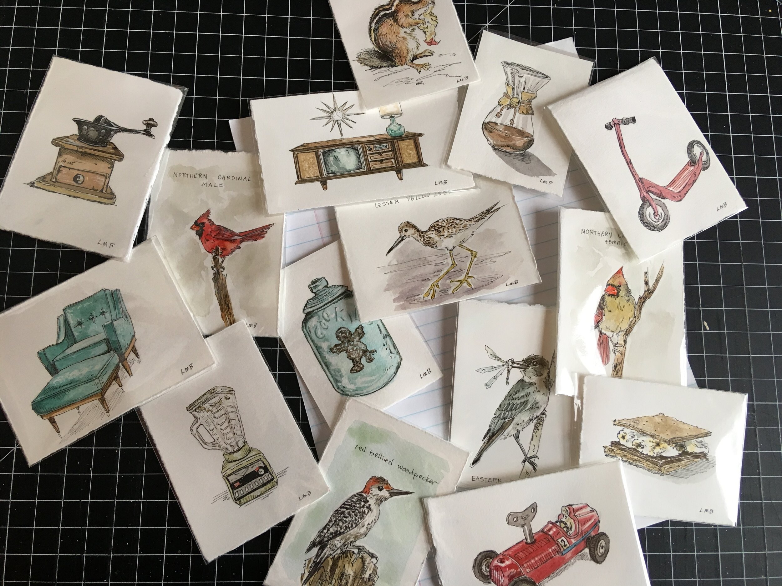 All the tiny scrap paper paintings! Watercolor and ink on paper.