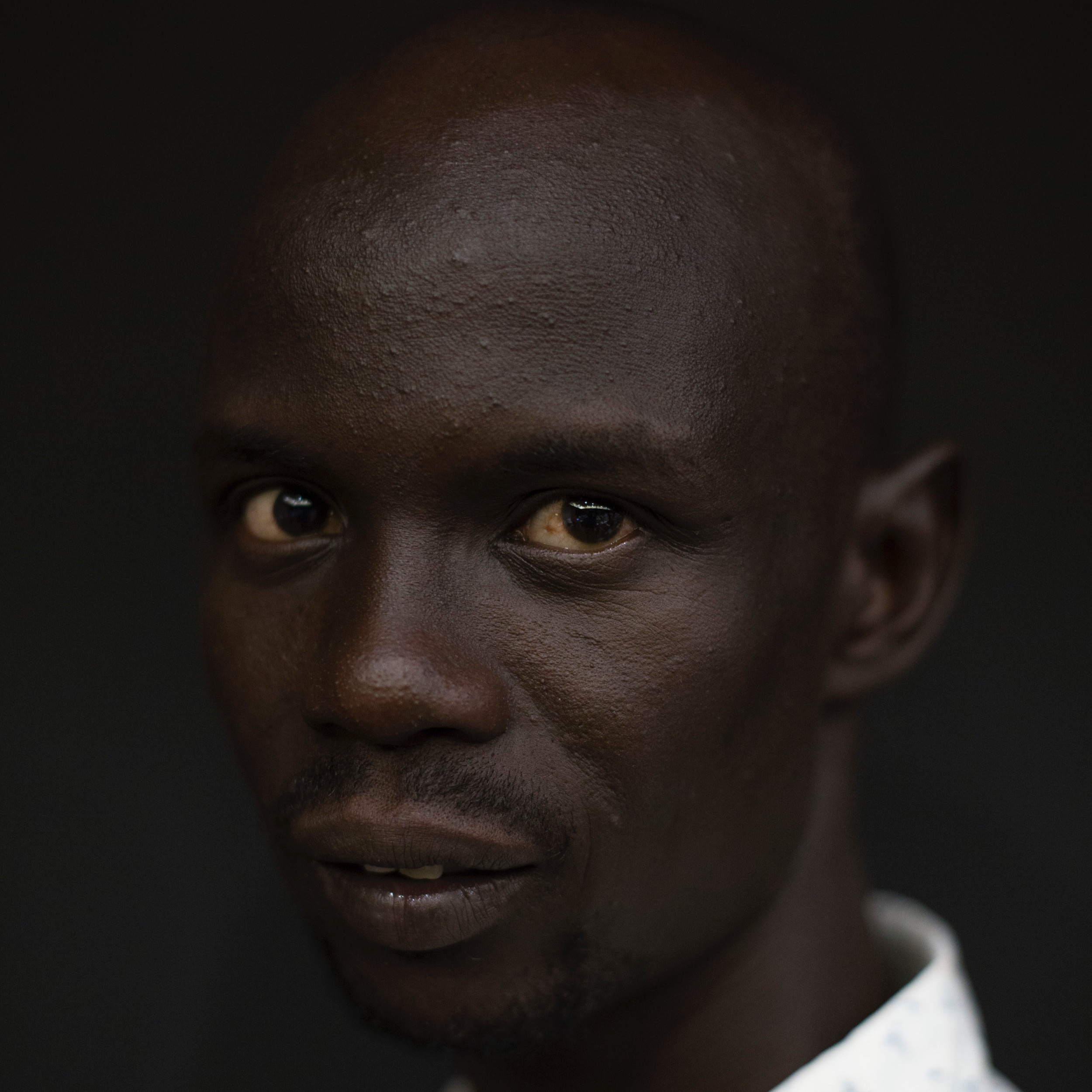 BULLEN CHOL  Bullen Chol (Akuot Chol Mayak) is an independent photographer and filmmaker dedicated to documenting social and political issues in South Sudan. He contributes to various newspapers and news agencies around the world.   @bullen_chol