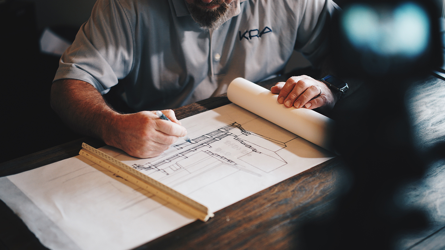 Male architect drawing plans