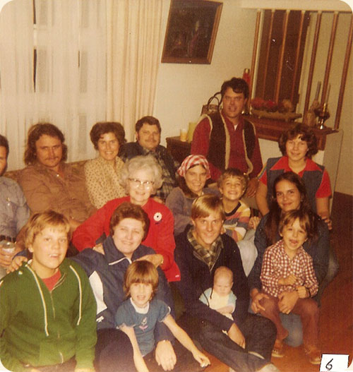 November 1980 (Thanksgiving) / Chapel Hill, N.C.  L-R rear Richard Walter, Skipper Brice, Carole W. Earle, Jimmy Walter, John Earle, Jr. L-R next Jeffrey Earle, Sandra P. Walter, Ruth J. Walter, Rose Mary J. Walter w/ Kevin Earle, Anna M. Walter, 3rd row Sarah A. Walter, Michael Earle, Elizabeth B. Wicker holding Dwayne Wicker. Note doll in photo.