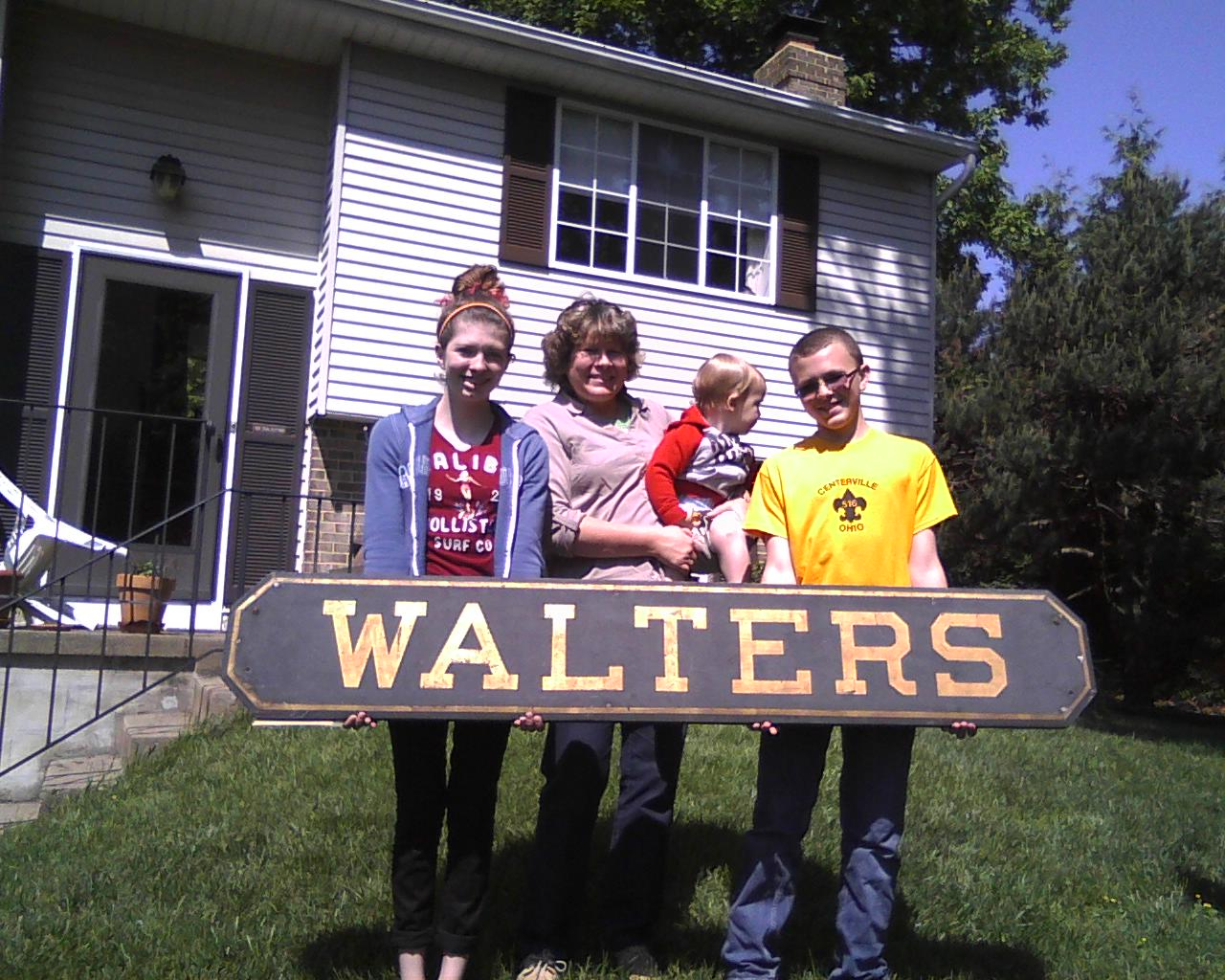 May 12, 2013 / Vienna, VA  Lehigh Valley Railroad, Easton & Northern Branch, railroad passenger station sign from Walters, {Easton} Northampton County, PA  Holding the railroad station sign originally from Walters Upper Mill Station or Walters Lower Mill Station {near Easton, Pennsylvania.} Left to right Megan R. Walter-Johnson, Anna Marie Walter, Carter T. Walter-Johnson, Jacob D. Walter-Johnson of Centreville, VA {wearing a scout shirt gift from Centerville, OH troop, seen on one of two photos}.  Anna is the daughter of the writer, Megan and Jacob grandchildren and Carter a great grand child. Photographed by Richard J. Walter of Vienna, VA  Note: It is believed the sign actually came from the Walters Lower Mill Station.
