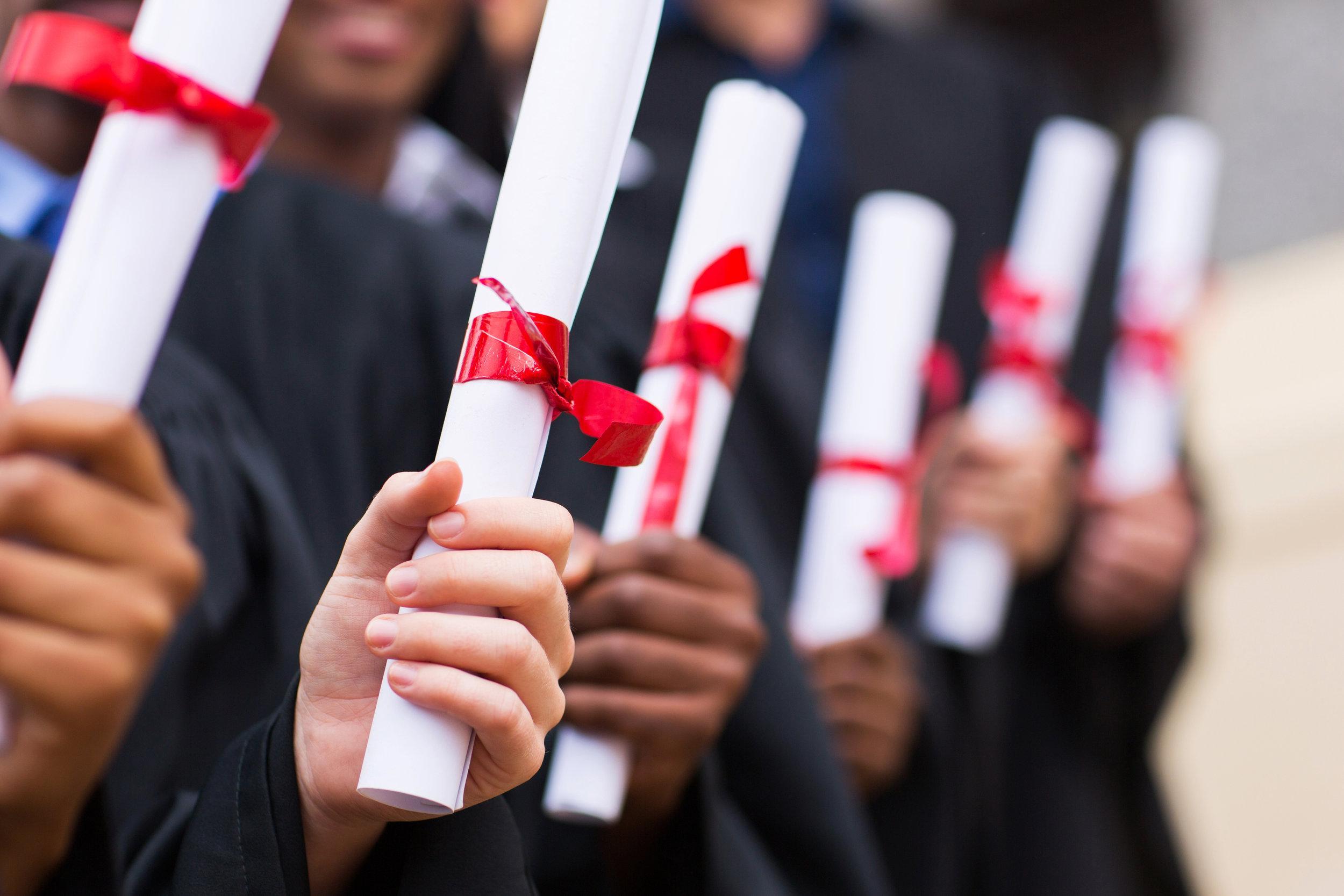 Graduates prepare to listen to a graduation speech