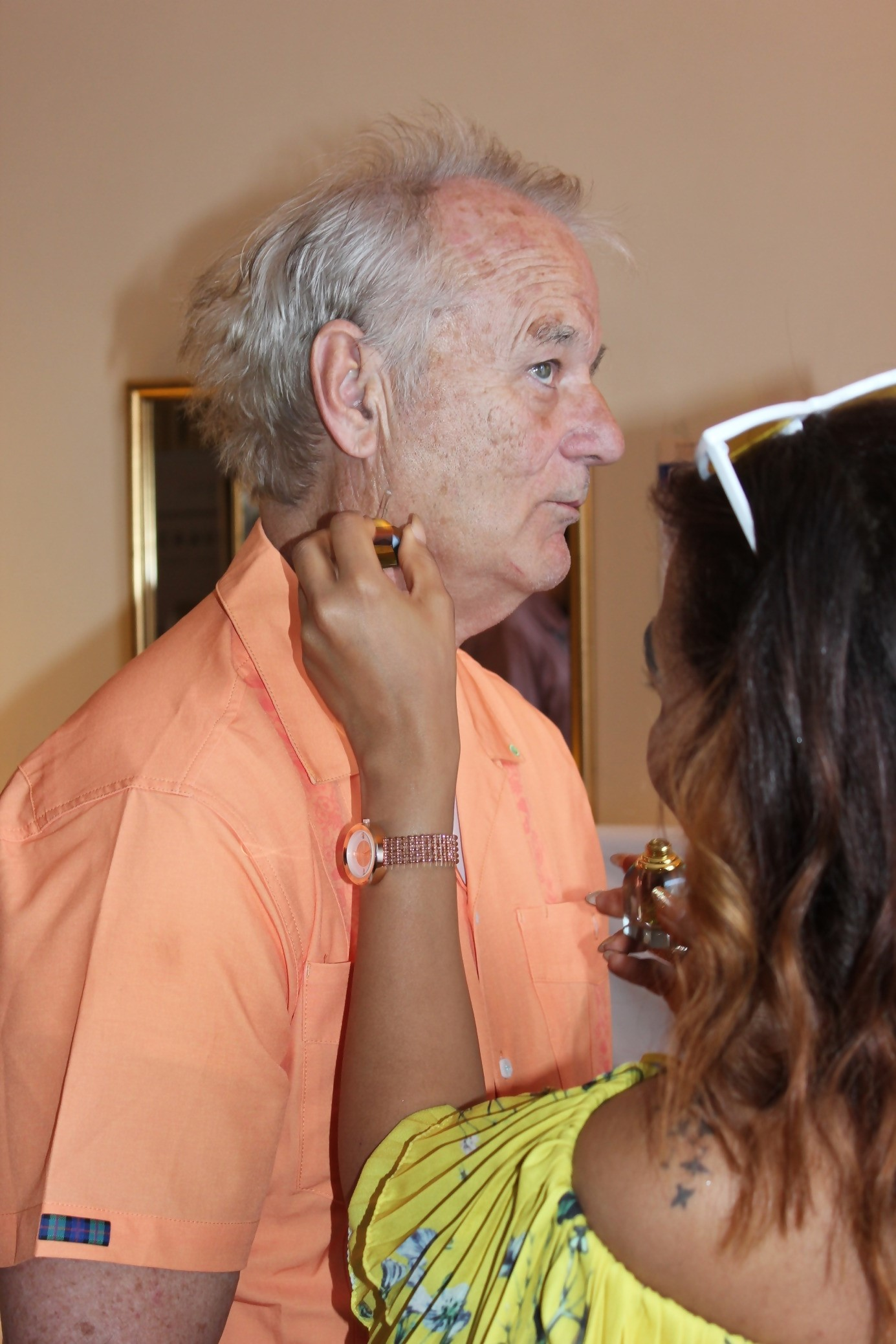 Me putting more E.F. Nomad on Bill Murray during Cannes Film Festival (DPA Celebrity Suite)