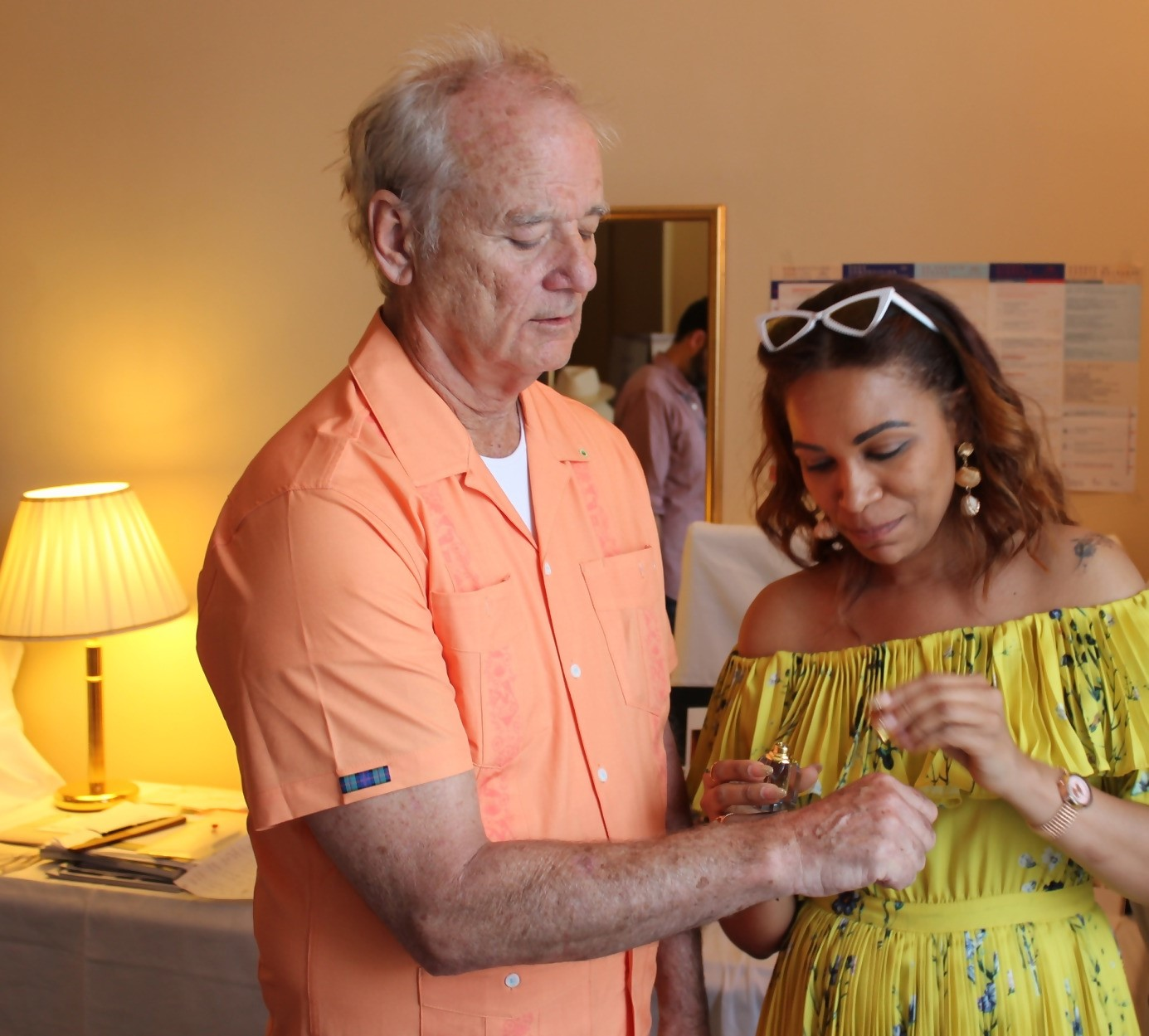 Me putting even more E.F. Nomad on Bill Murray during Cannes Film Festival (DPA Celebrity Suite)