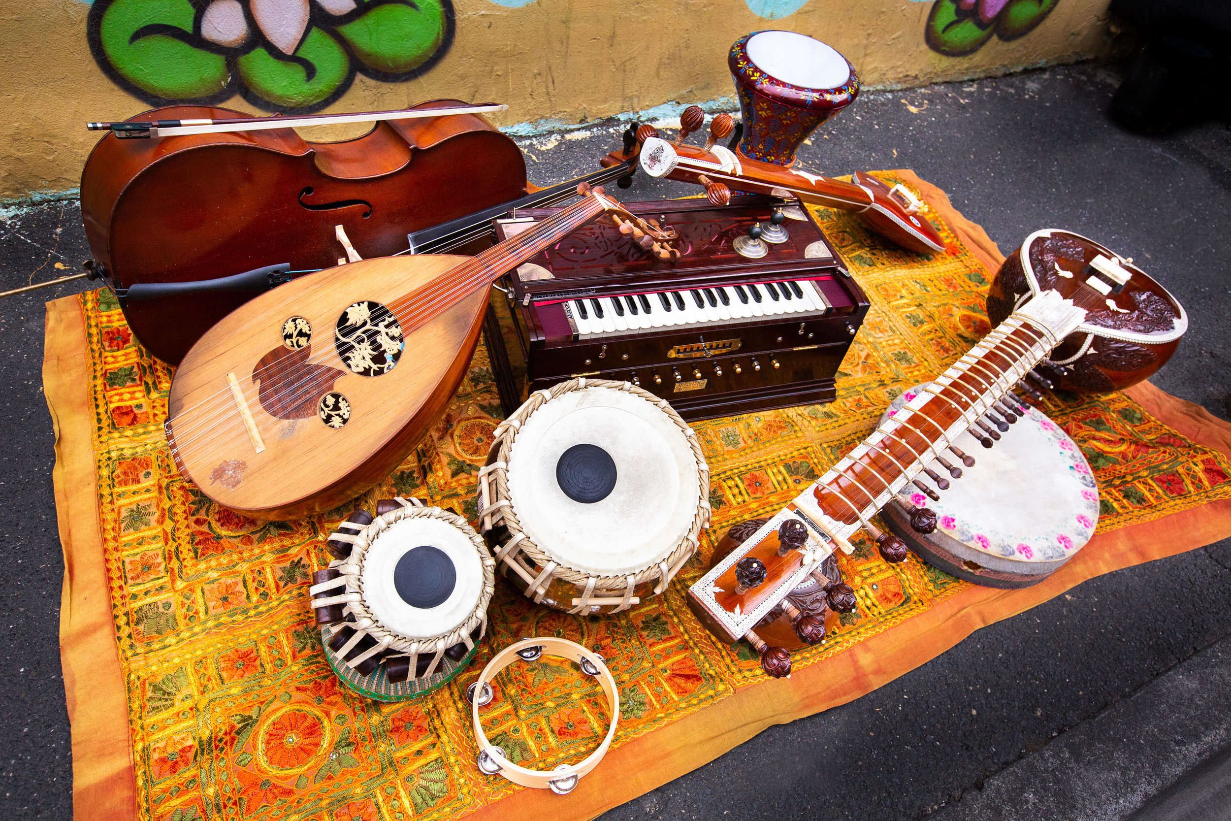 Vedic Vibe instruments include (clockwise from left): Cello, oud, harmonium, tamboura, derebouka, sitar, frame drum, tablas and tambourine. photographer: peter casamento.