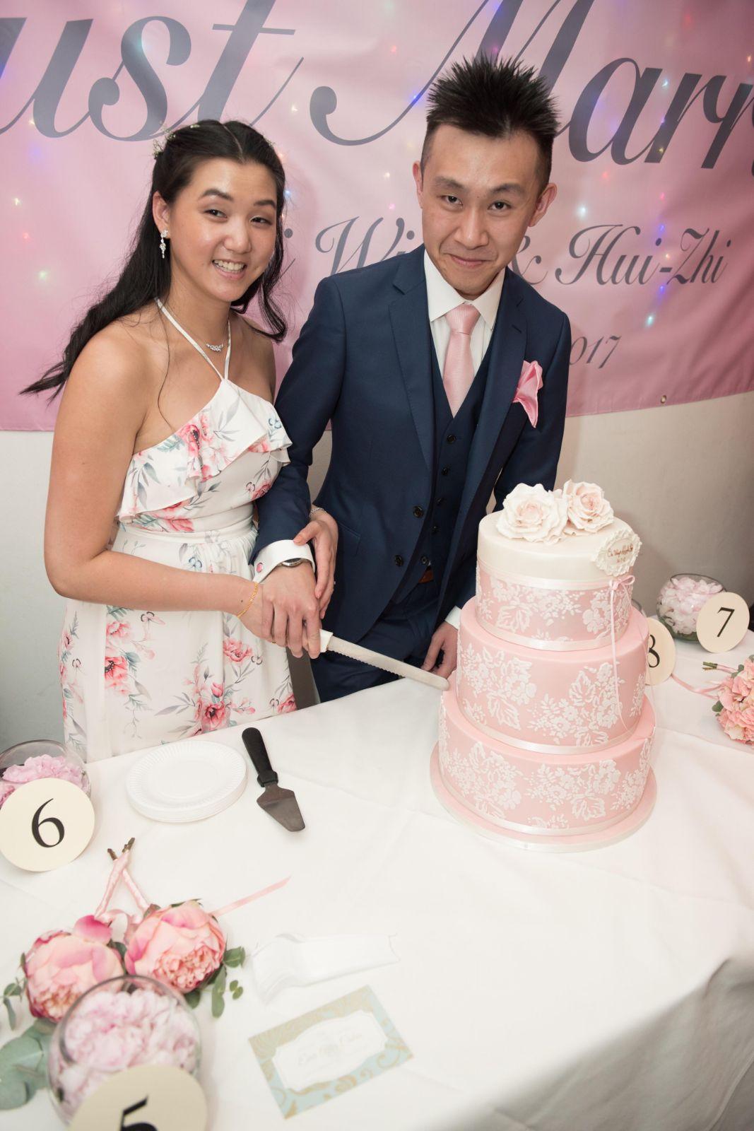 Weeta cutting Pink Cake.jpg