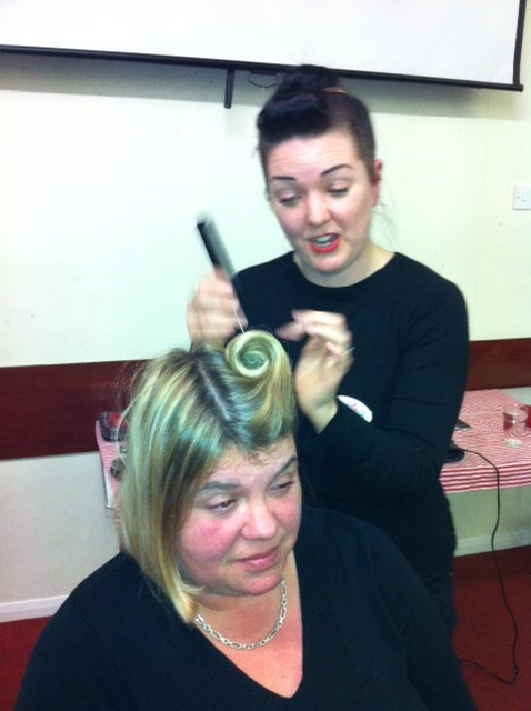 February 2013:  Amanda from Lipstick and Curls came and talked to us about vintage hairstyles and cosmetics, demonstrated on a couple of members.