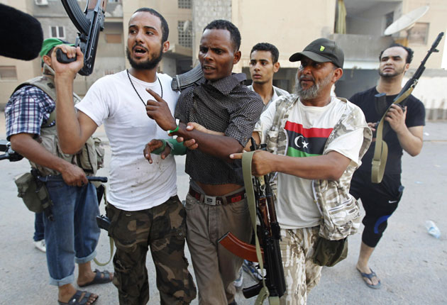 "Britain's so-called   Independent   used this image in a story titled ""Rebels settle scores in Libyan capital"""