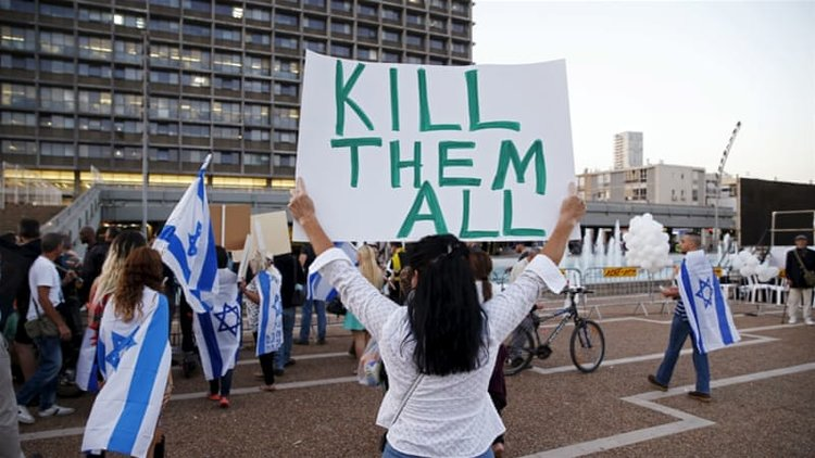 """It's okay to be racist in Israel"": Supporters of an Israeli soldier, Elor Azaria, charged with manslaughter after he shot a wounded Palestinian alleged attacker as he lay on the ground in Hebron in 2016 [Reuters]"