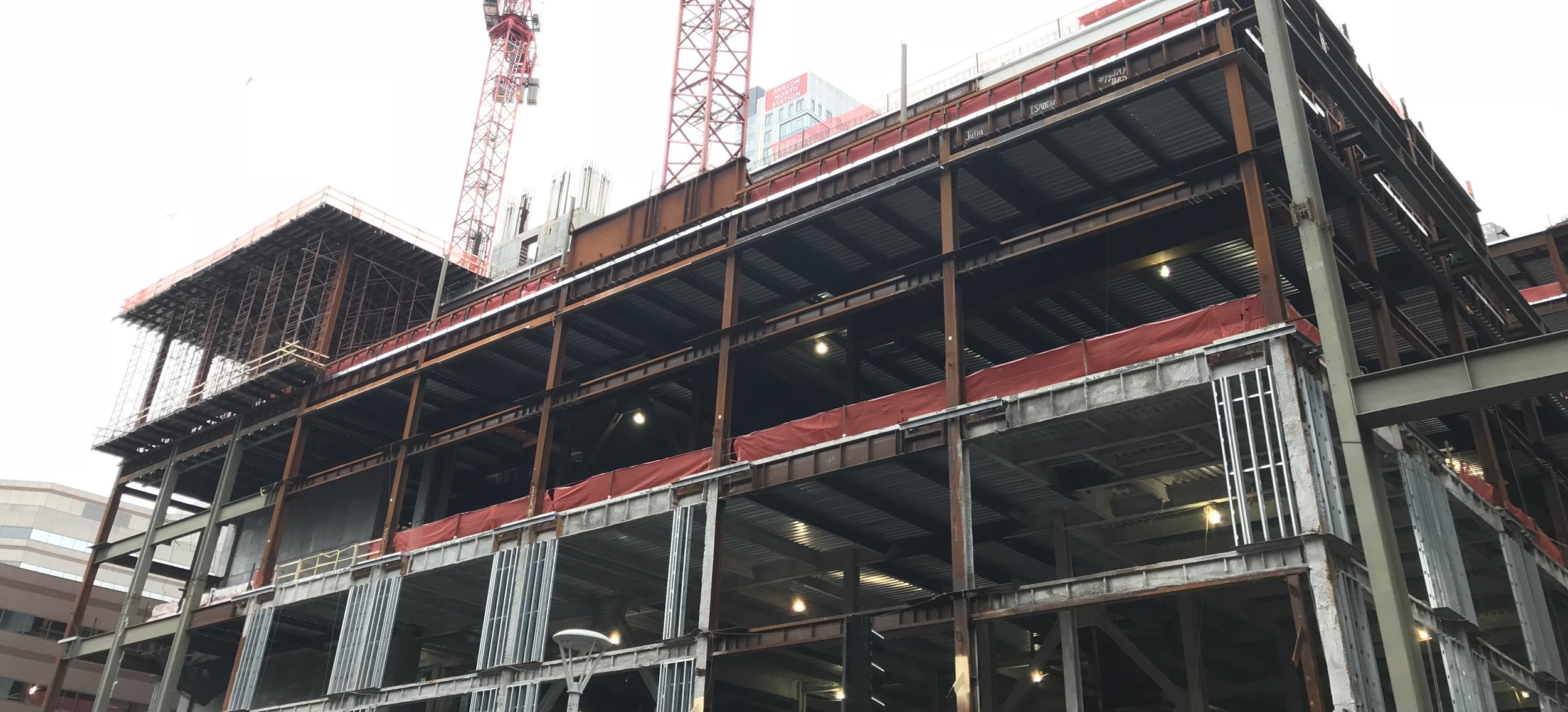 Image: A large building under construction, with exposed girders visible. The building's structure is clearly visible.