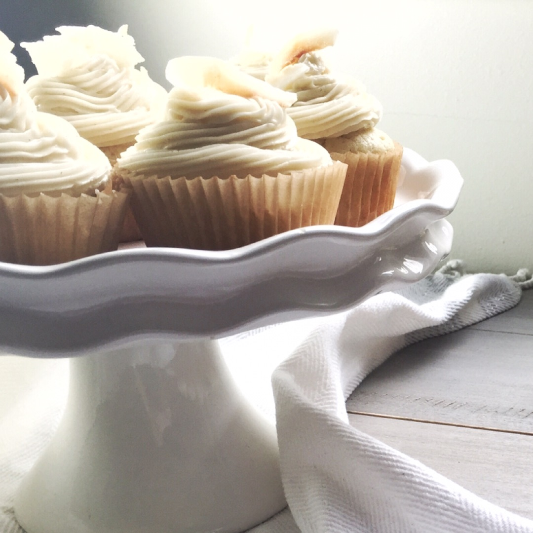 Coconut Cupcakes with Vanilla Frosting - Prep: 25 MINCook: 20 MINWait time: 20 MINTotal: 65 MINServings: 18