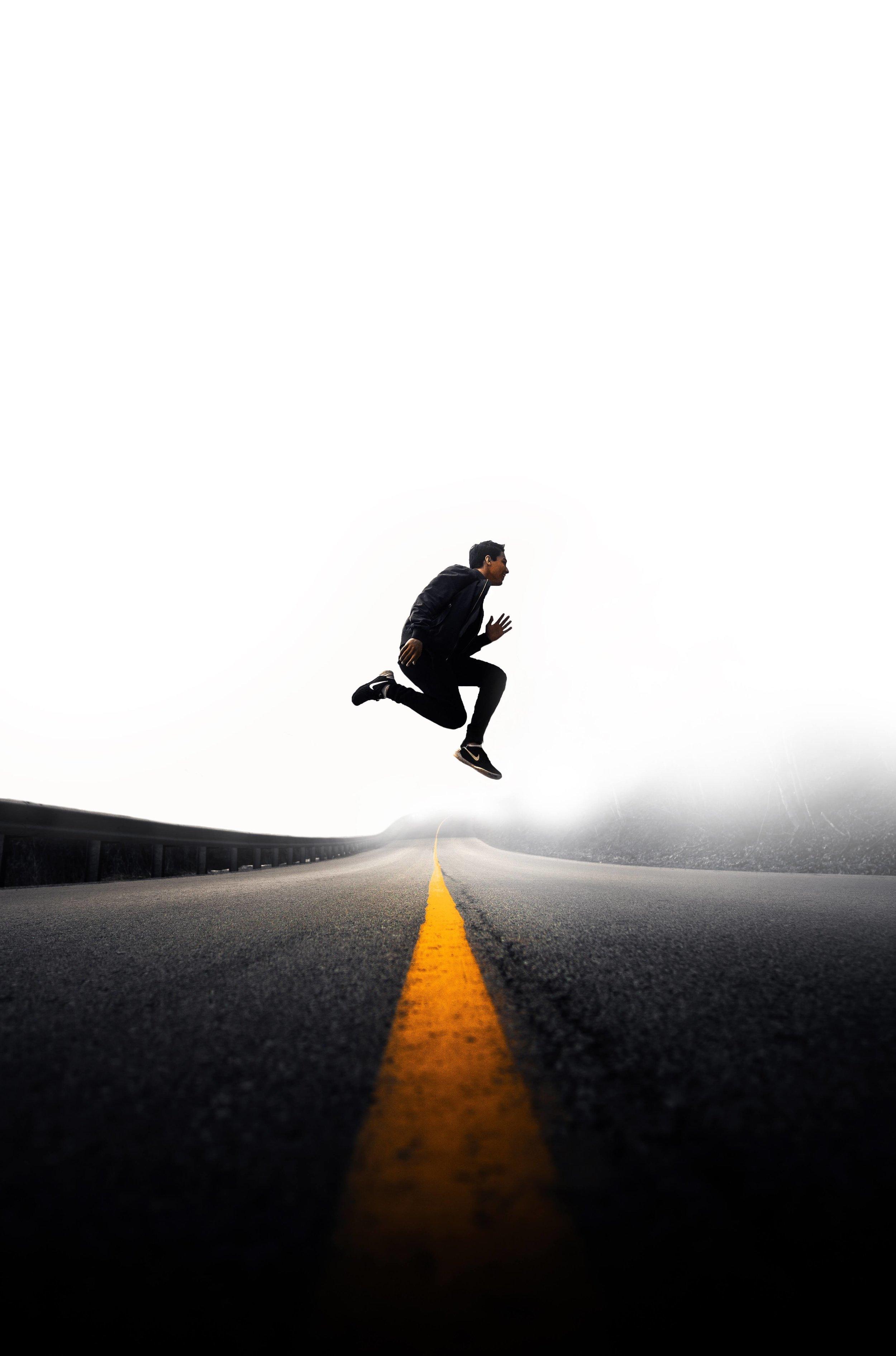 line jumper man jumps over street line running