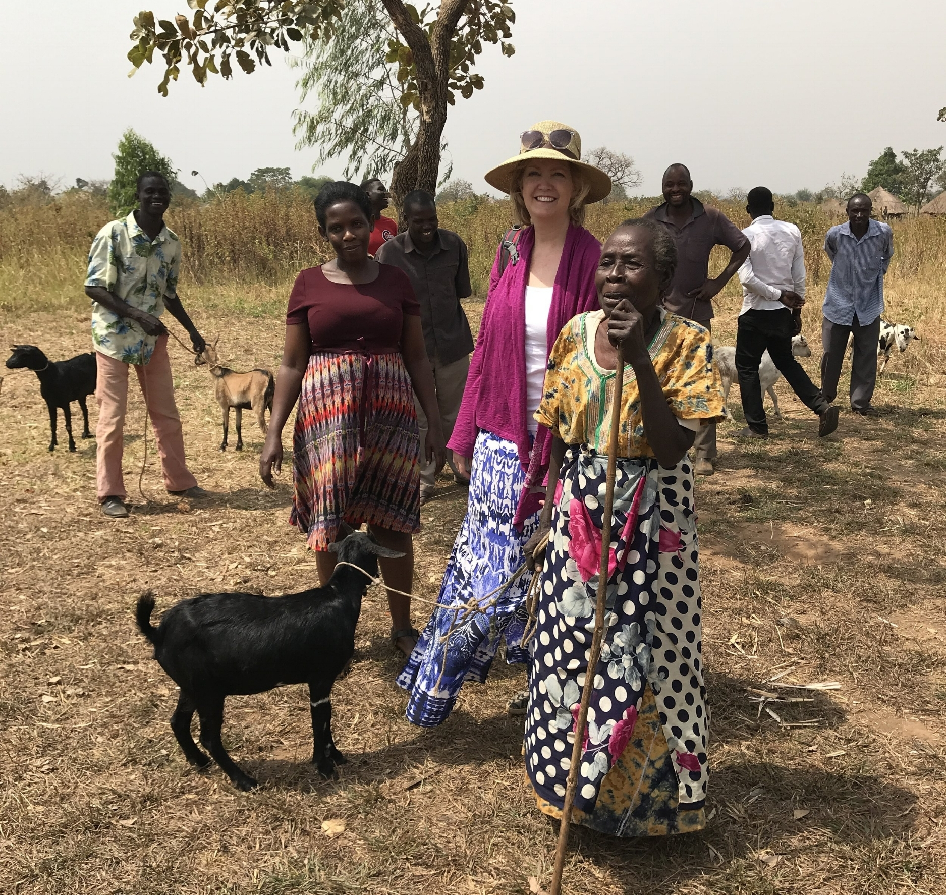 Allen Odoi and Tobi Moriarty giving out goats in January 2018