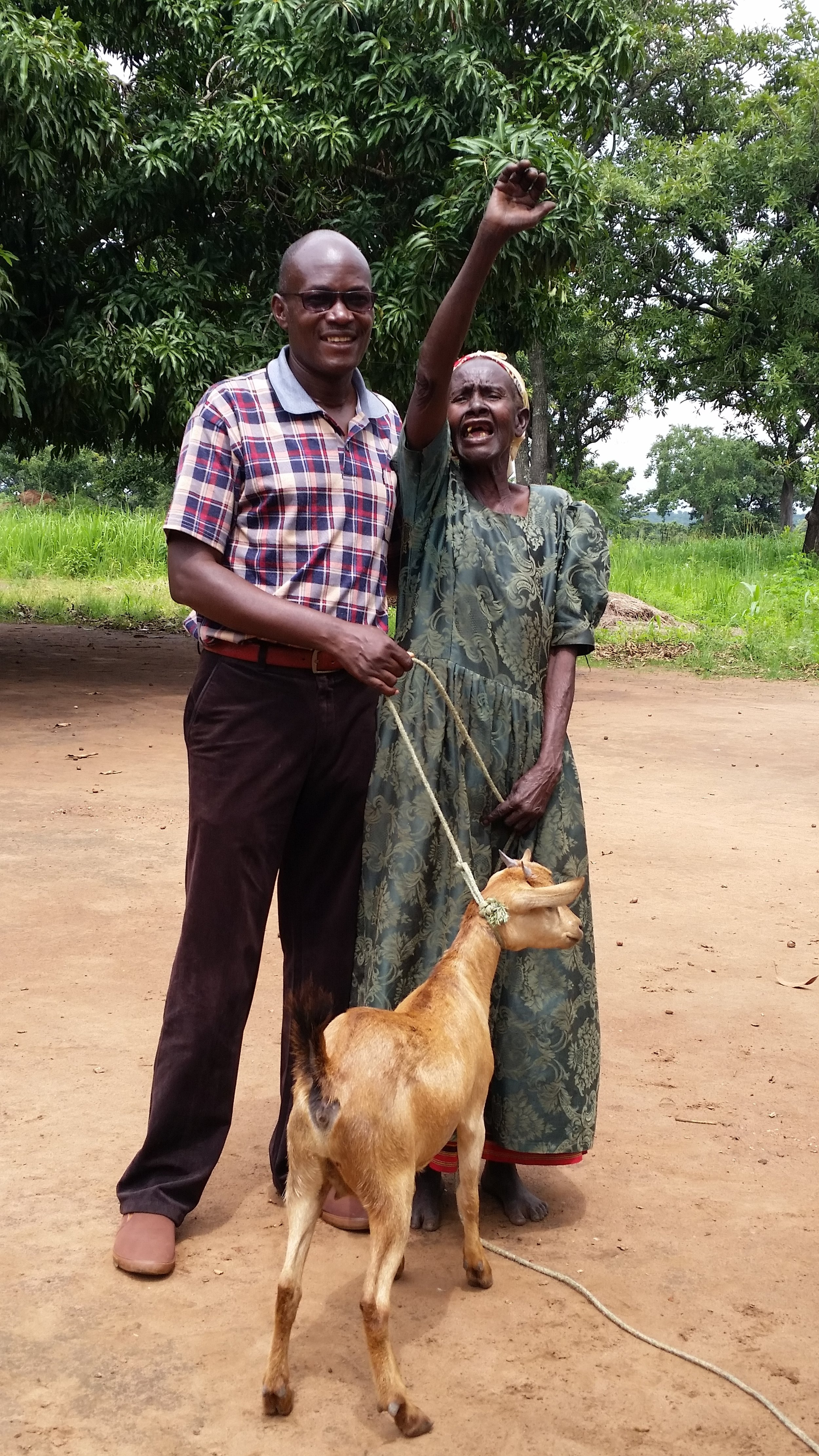Joy of a  beneficiary in receiving a goat in Pader district (June 2019)