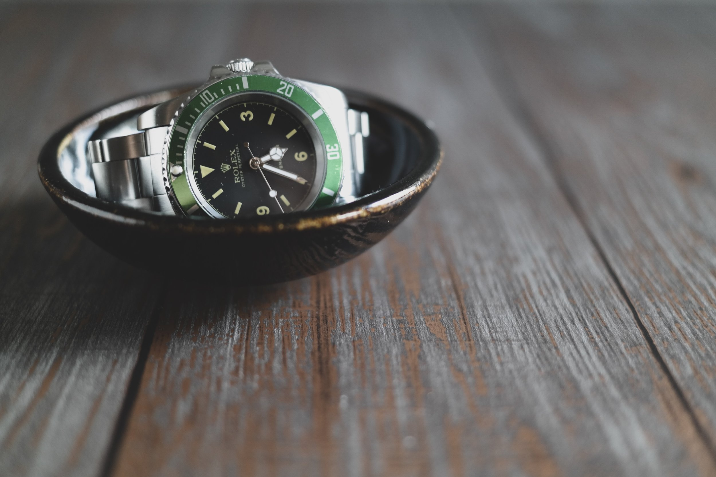 My Rolex Kermit Submariner in handmade bowl by @jonthepotter. Shot by me on Samsung NX300.