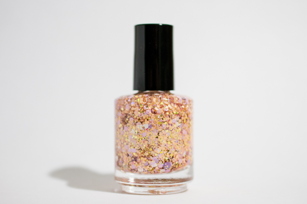 A Ferry Nice Day - Cute white heart glitters, peach, pink, violet and gold glitters in a clear nail polish base.