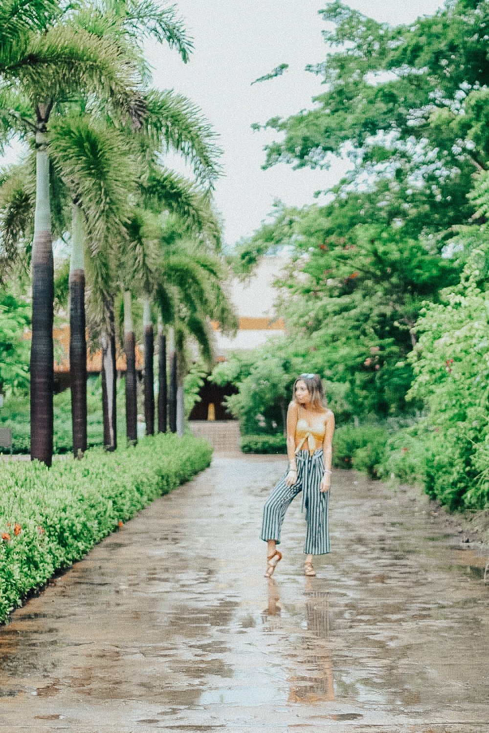 "This picture was 100% taken in the rain… at 7am lol. As I said, it rained a lot while we were there but we weren't gonna let it stop us from enjoying the day. We weren't even phased by it, just apart of the whole ""jungle girl"" lifestyle we were rocking. - Top 