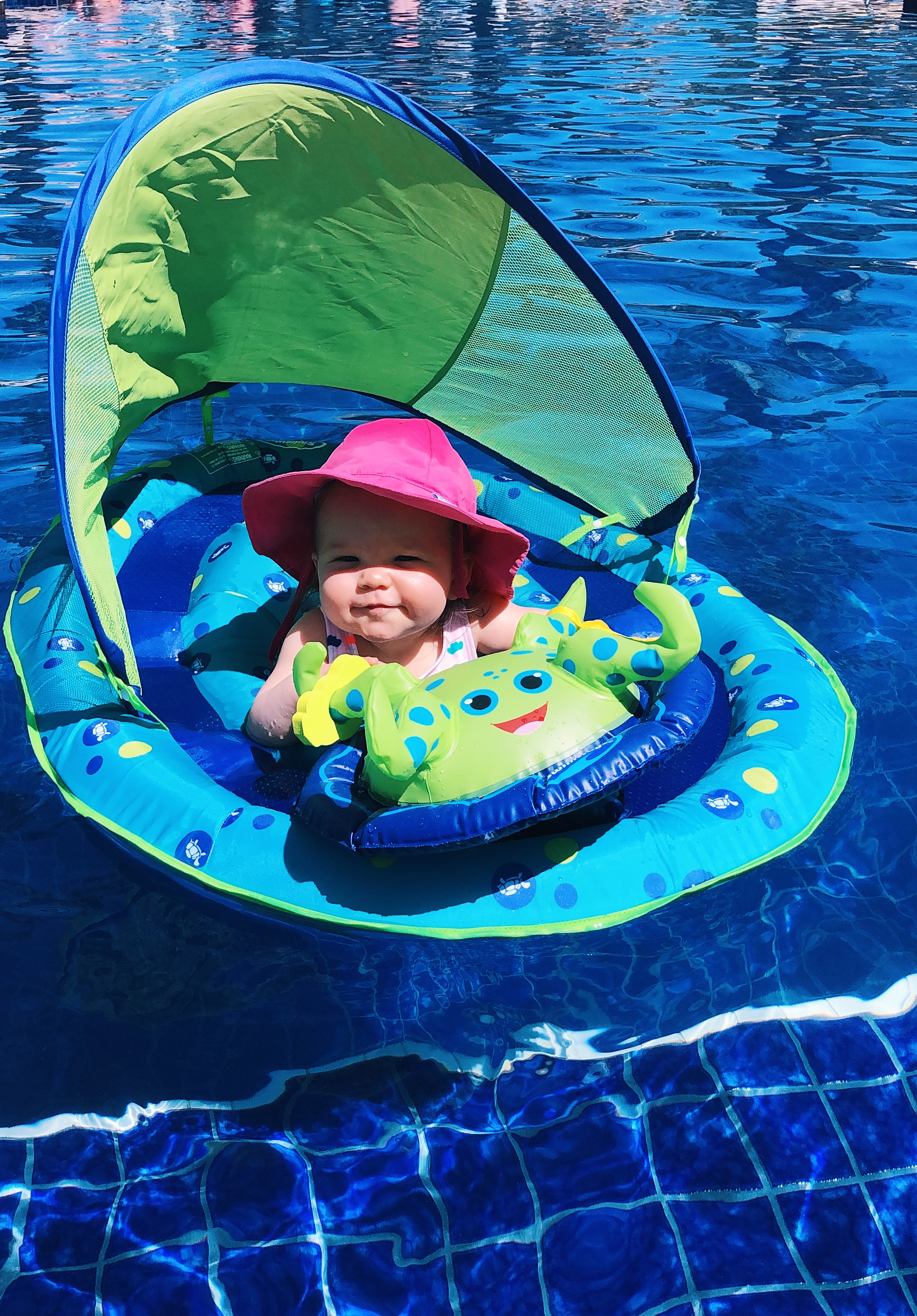 Protecting that sweet baby skin of hers was a must for this trip. We loaded on the sunscreen but also had her in a hat if she was in the pool. Although not the cutest hat I've ever seen it was SPF 50 and Sophie didn't seem to mind it. You can find this sun blockin' hat  here . She loved the floatie and you can find it  here .