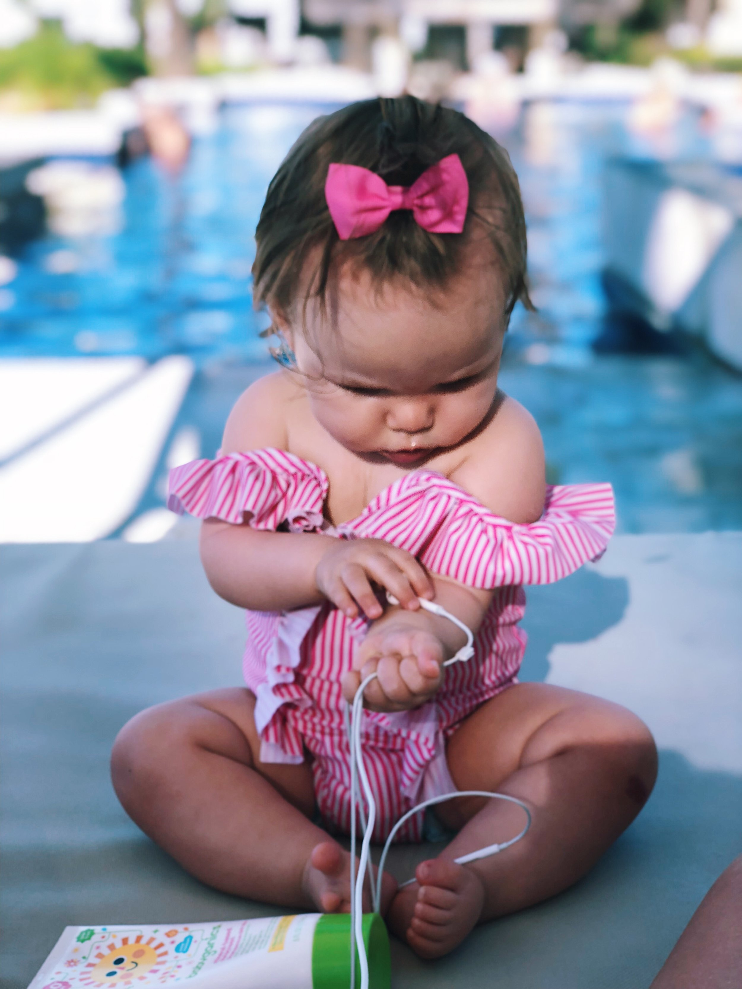 Pink is not something you will find a lot of in my closet but I would say you can find it in 90% of Sophie's. So when you have a bathing suit that is pink and has some ruffles on it, you can guarantee that she has to have it. :) You can find this pink little number  here .