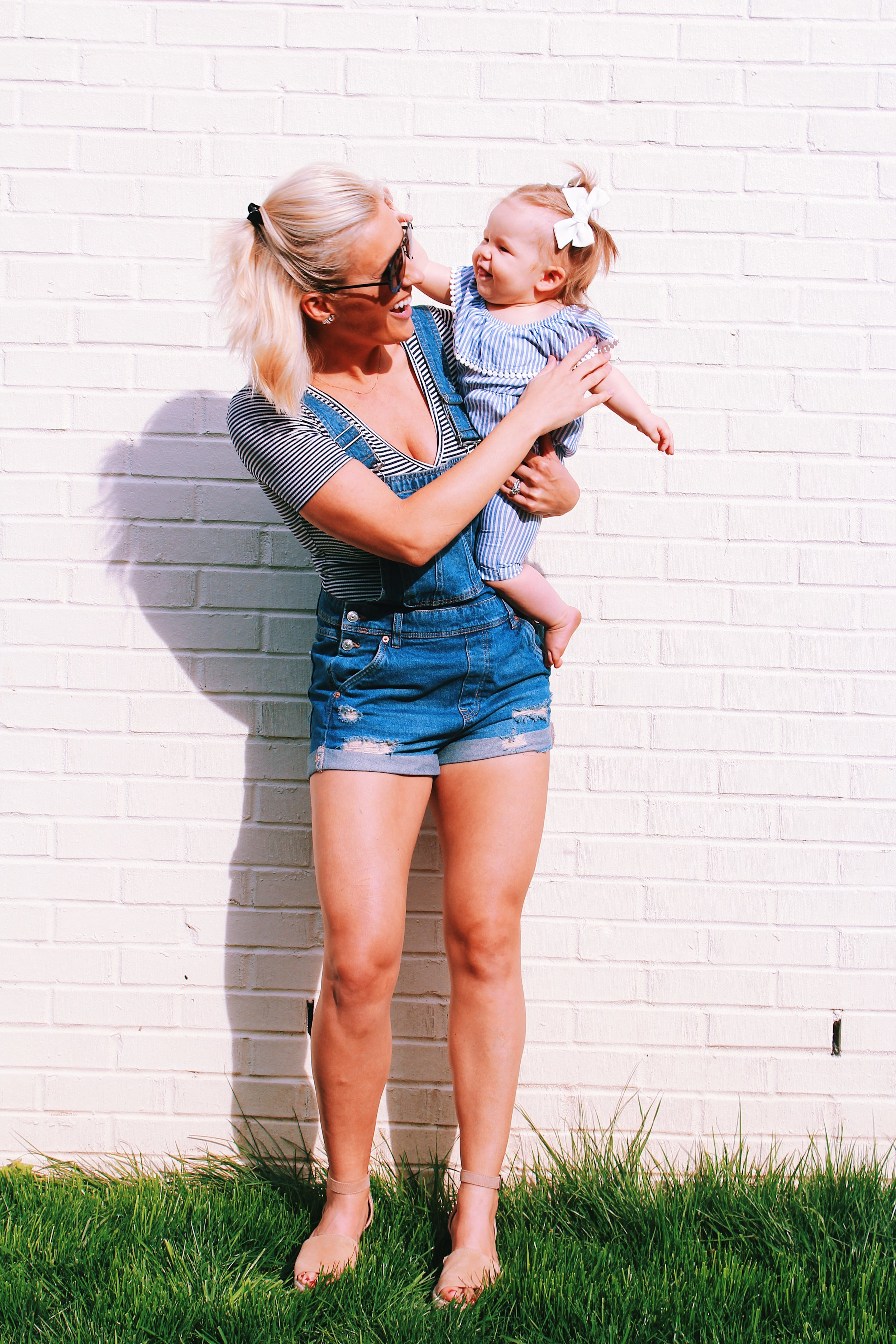 OUTFIT DEETS:  Overalls  (size 6)  Similar pair of Overalls in case mine are still sold out |  B  odysuit  |  Wedges  |  Earrings  |  Sunglasses  | Sophie Romper  |  Sophie Bows