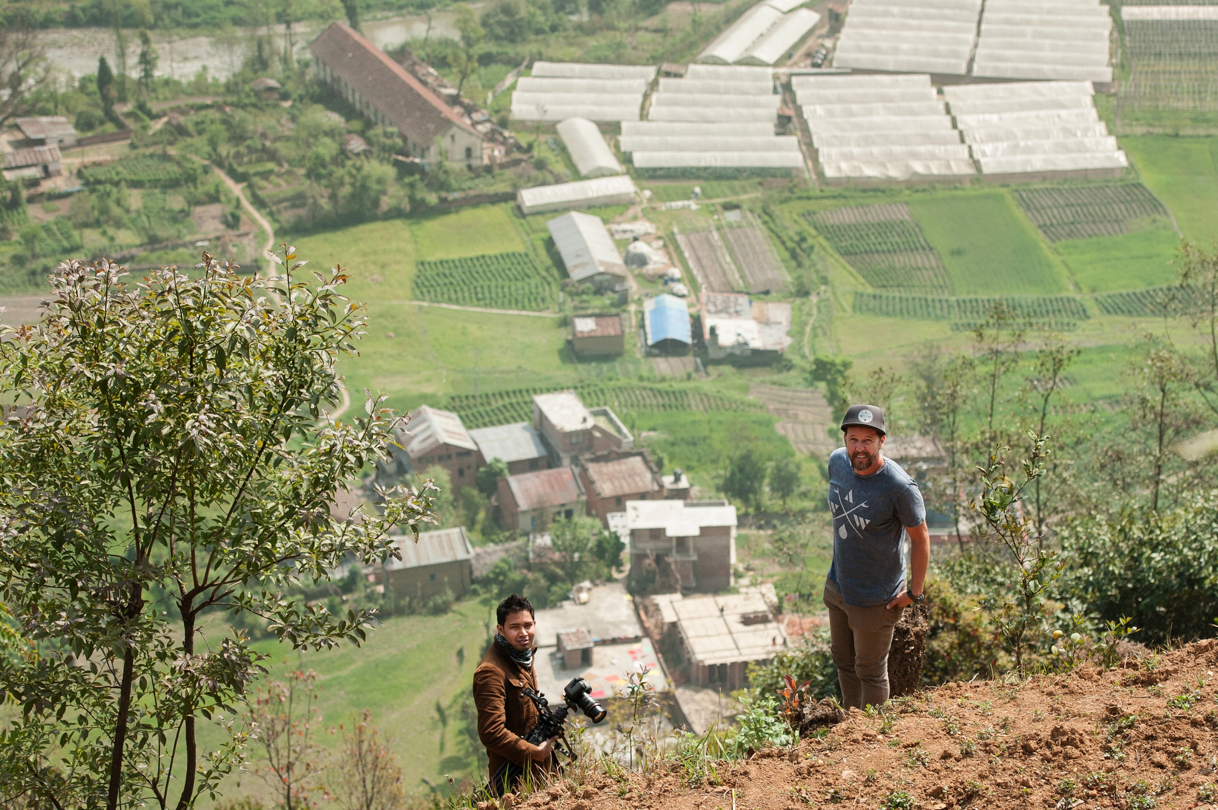 Bikash Pariyar (L) from Nepal and Dathan Graham (R) work together to document Khokana Leper Colony from above.