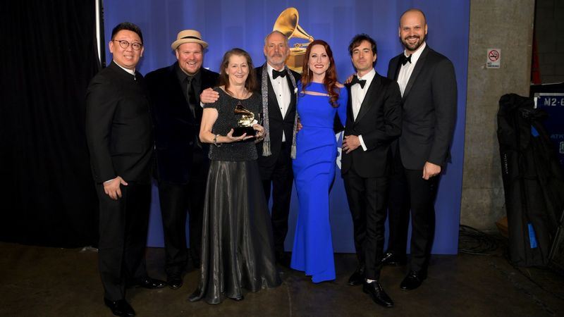"The team behind opera recording winner ""The (R)evolution of Steve Jobs,"" including composer Mason Bates, second from right, and Edward Parks, who played Jobs, far right, pose backstage at the Grammy Awards' pre-telecast ceremony Sunday at Microsoft Theater in L.A. (Emma McIntyre / Getty)"